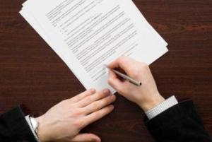 2968-business-man-signing-papers